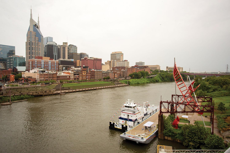 The Youngsuk Chi with the Nashville skyline in the background. (Photo courtesy of Ingram Barge Company)