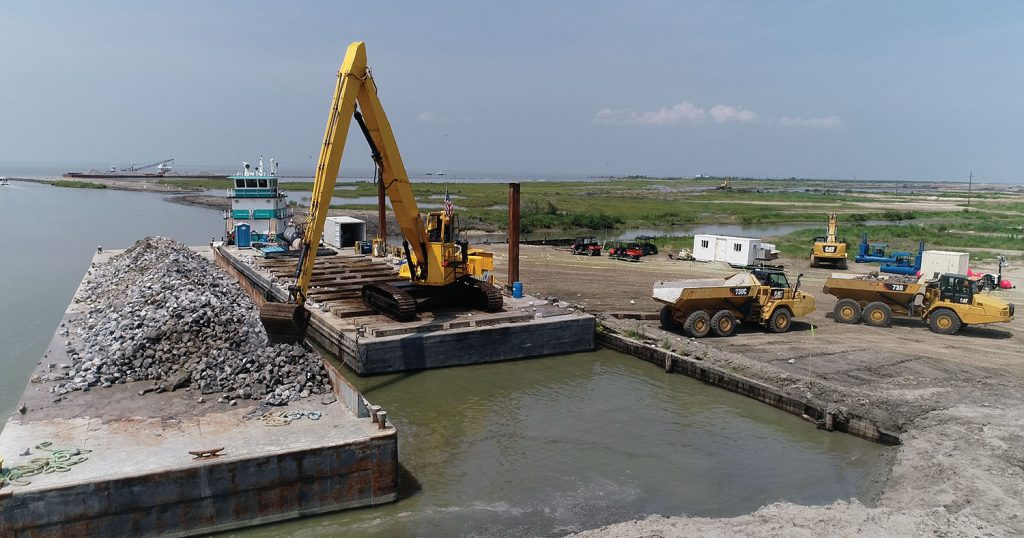 Weeks Marine is the primary contractor on the project with Madere & Sons Towing/Deep South Construction and Salvage subcontracting an armor stone wall and Daulton Barge Leasing, Sales & Management providing 15 deck barges to haul the stone. (Photo courtesy of Daulton Barge Leasing, Sales & Management)