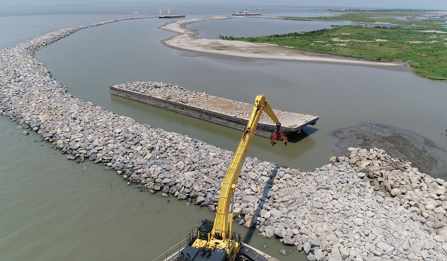 The West Grand Terre Beach Nourishment and Stabilization Project is using nearly 2.5 million cubic yards of dredged sand and close to 50,000 tons of armor stone to restore the shoreline of West Grand Terre Island. The beaches, dunes and marshes protect communities between New Orleans' west bank and Bayou Lafourche. (Photo courtesy of Daulton Barge Leasing, Sales & Management)